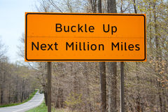 Orange Buckle Up Next Million Miles Sign Stock Photo
