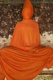 Orange buddha bangkok thailand. Enigamtic buddha wat suthat buddhist temple in bangkoks old city thailand Stock Photos