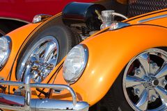 Orange Bug. Retro orange bug with showing fender, engine, and wheel Stock Photo