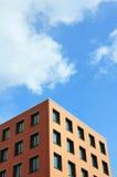 Orange building against sky. Orange building against blue sky stock photos