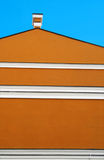 Orange building and blue sky royalty free stock photo