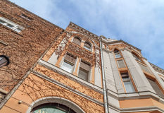 Orange building detail with blue cloudy sky Royalty Free Stock Photo