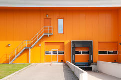 Orange building with loading dock Royalty Free Stock Photo