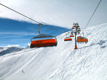 Orange bulbs of chair-lift. Royalty Free Stock Photography