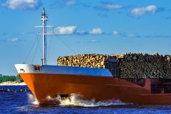 Orange bulk carrier. Sailing in clear summer day stock photos