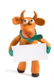 Orange bull. (symbol of 2009) made with plasticine with blank card in hands stock photos