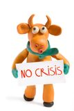 Orange bull. (symbol of 2009) made with plasticine with card in hands with phrase no crisis royalty free stock image
