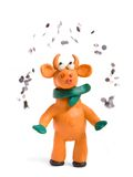Orange bull (symbol of 2009). Made with plasticine juggles with coins royalty free stock photos