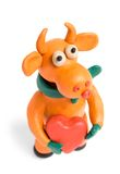 Orange bull with valentine. Orange bull (symbol of 2009) made with plasticine with heart in hands on white stock photography