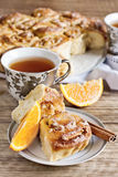 Orange bun cake. Bun/roll cake with orange, cinnamon and nuts. Selective focus Stock Photos