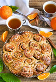 Orange bun cake. Bun/roll cake with orange, cinnamon and nuts. Selective focus Royalty Free Stock Photo