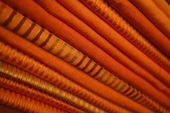 orange bunt för tyg Arkivfoton