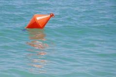 Orange buoy. Image of orange buoy floating on the sea Stock Photography