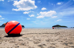 Orange buoy in the sand Royalty Free Stock Photography