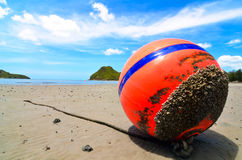 Orange buoy in the sand Stock Images