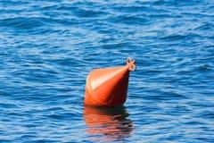 Orange buoy on the water Royalty Free Stock Photo