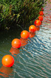 Orange buoys stock photo