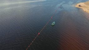 Orange buoys of safety on the river, fencing of the place of swimming on the beach. Aerial shooting stock footage