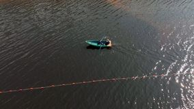 Orange buoys of safety on the river, fencing of the place of swimming on the beach. Aerial shooting stock video footage