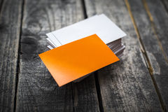 Orange business card identity mockup on wood Royalty Free Stock Images