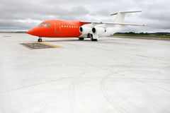 Orange business jet Stock Photography