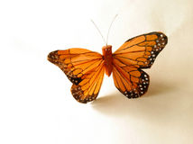 Orange butterfly. Artificial orange butterfly isolated on white background stock images