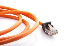 Orange cable. Orange communication cable with connector closeup view Royalty Free Stock Photos