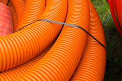 Orange cable hoses Stock Images