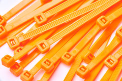 Orange cable ties. Commercial photo on white background. Stock Image