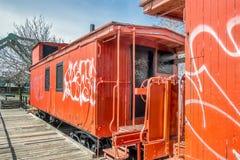 Orange Caboose train royalty free stock image