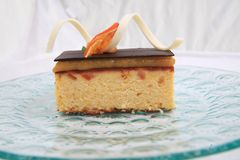 Orange cake. Photograph of orange cake on black background Royalty Free Stock Images