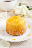 Orange cake. On a white plate with zest Royalty Free Stock Image