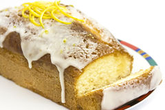 Orange cake. With icing and slice royalty free stock photos