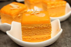 Orange cake with almond slice on top Stock Images