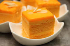 Orange cake with almond slice on top Royalty Free Stock Photography