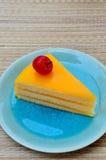 Orange cake in blue dish Stock Image
