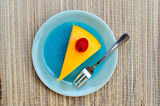 Orange cake in blue dish Royalty Free Stock Photo