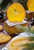 Orange cake with caramelized oranges, christmas decoration Stock Photos