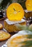 Orange cake with caramelized oranges, christmas decoration Stock Photos