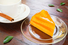 Orange cake with coffee cup Royalty Free Stock Photo