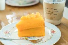 Orange cake and cold coffee Stock Photos