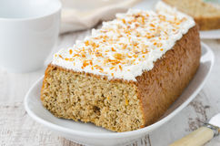 Orange cake with cream cheese icing, horizontal Royalty Free Stock Photo