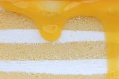 Orange cake. And cream full background Stock Photography