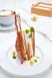 Orange cake with custard, white chocolate and caramel decoration Royalty Free Stock Photos