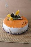 Orange cake with decoration on it Stock Photo