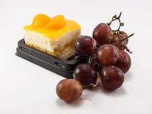 Orange cake and grapes Royalty Free Stock Photo