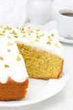 Orange cake with Greek yogurt, honey and nuts in a cut Stock Image