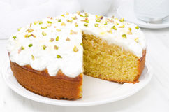 Orange cake with Greek yogurt, honey and pistachios in a cut Stock Images