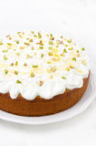 Orange cake with Greek yogurt, honey and pistachios on a plate Stock Photo