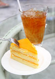 Orange cake with iced tea Stock Images